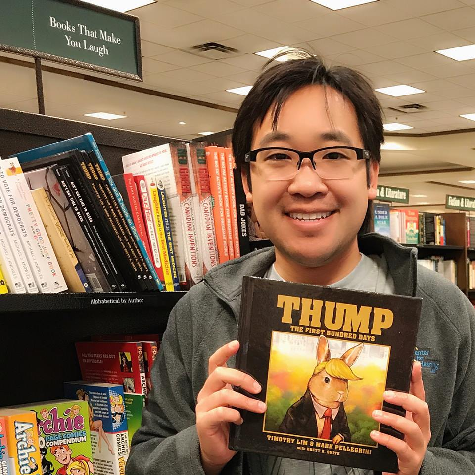 Illustrator Timothy Lim with a copy of Thump: The First Bundred Days
